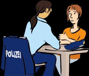 Eine Frau spricht mit der Polizei.